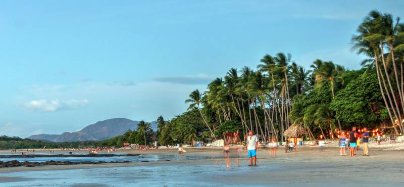 The blue waters and palm trees of Tamarindo beach in Costa Rica