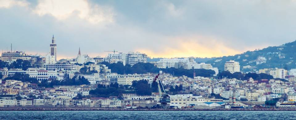 White washed buildings sitting along the waterfront in Tangier