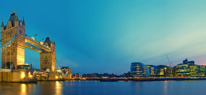 Panoramic view of Tower Bridge on the River Thames in London as dusk settles on the city