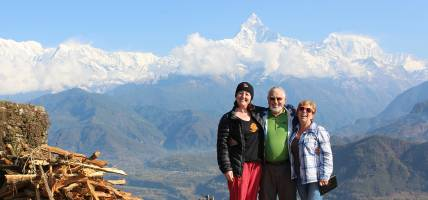 Travellers in Pokhara with Machhapuchhre Peak behind