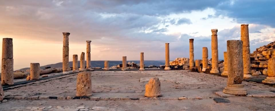 Pillars against the setting sun at Umm Qais