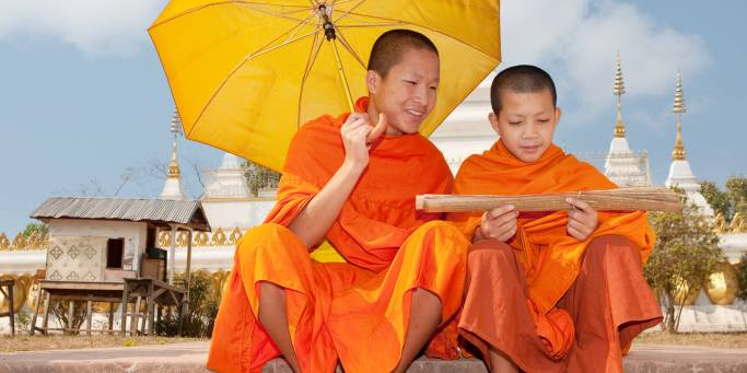 You'll see plenty of Buddhist monks on our tours to Laos