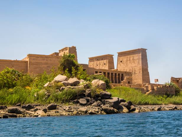 Ancient ruins standing majestically against the sky in Aswan