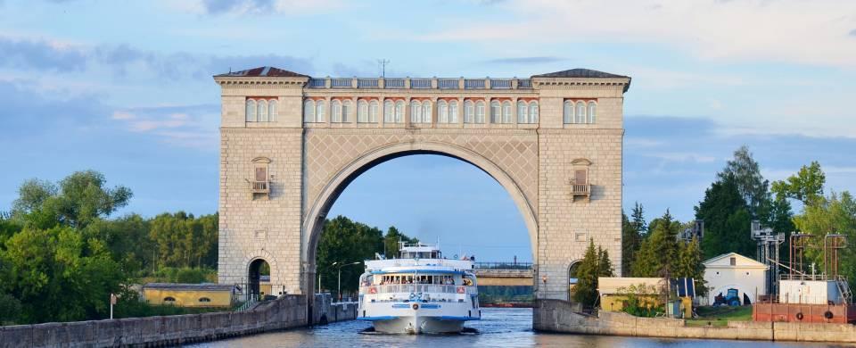 Cruise boat sailing through sluice gates on the River Volga in Russia