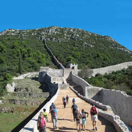 Walking along the wall of Ston - Croatia Tours - On The Go Tours