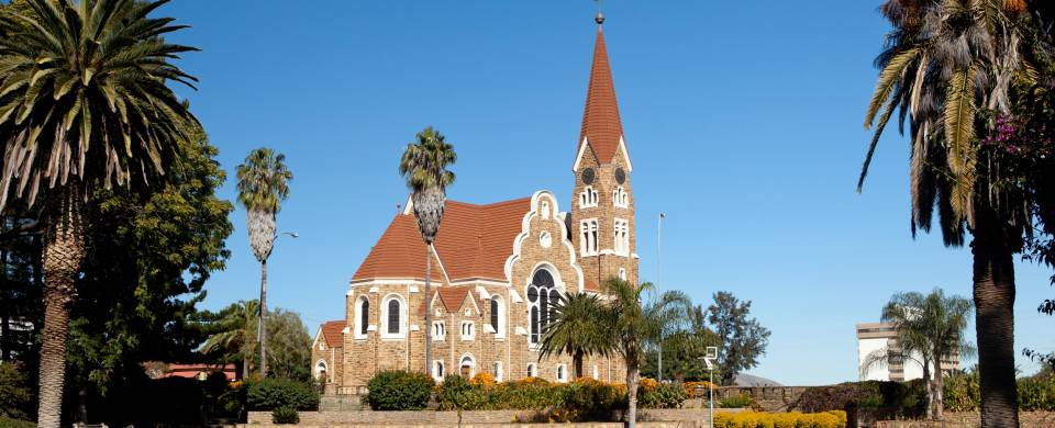 Church in Windhoek with palm trees and bright blue sky