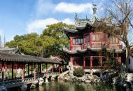 A traditional wooden pavilion and walkway in the attractive Yu Yuan Gardens in Shanghai