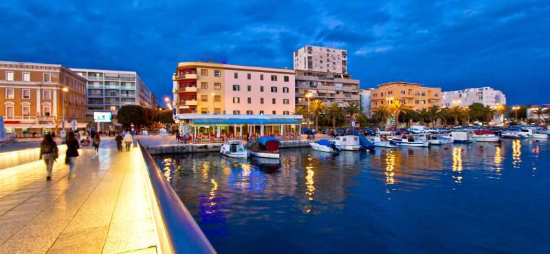 Boats in the harbour of Zadar, lit up in the evening