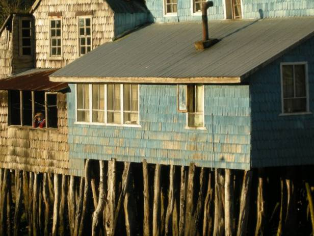 View of houses on stilts along the waterfront of Chile