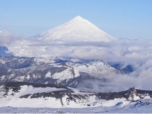 Snowy volcano behind the town of Purcon